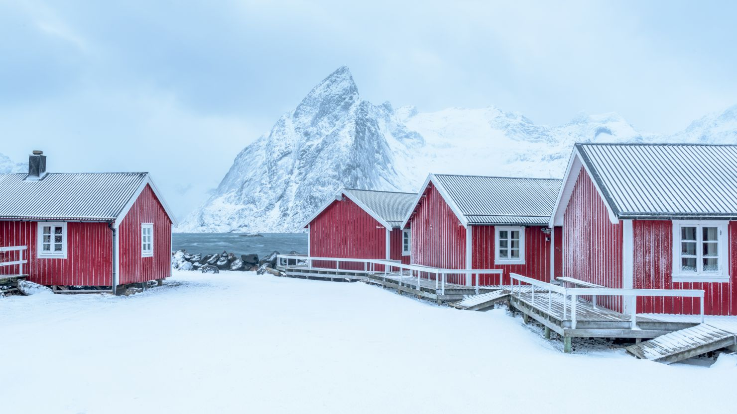 Red cabins and mountainn in winter