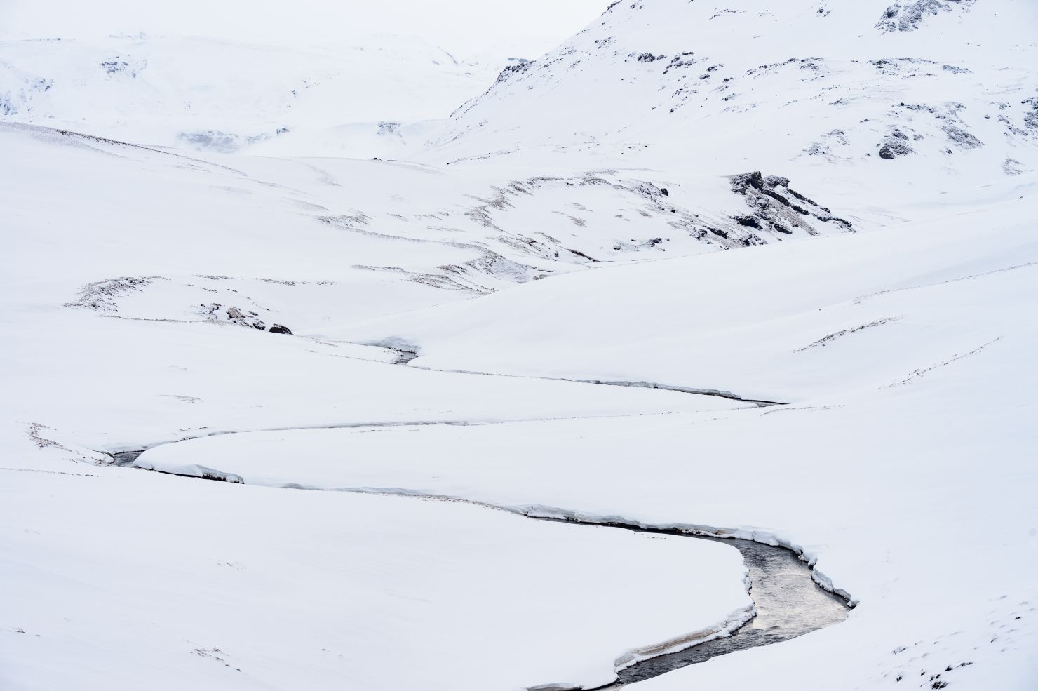 River meandering through the snow