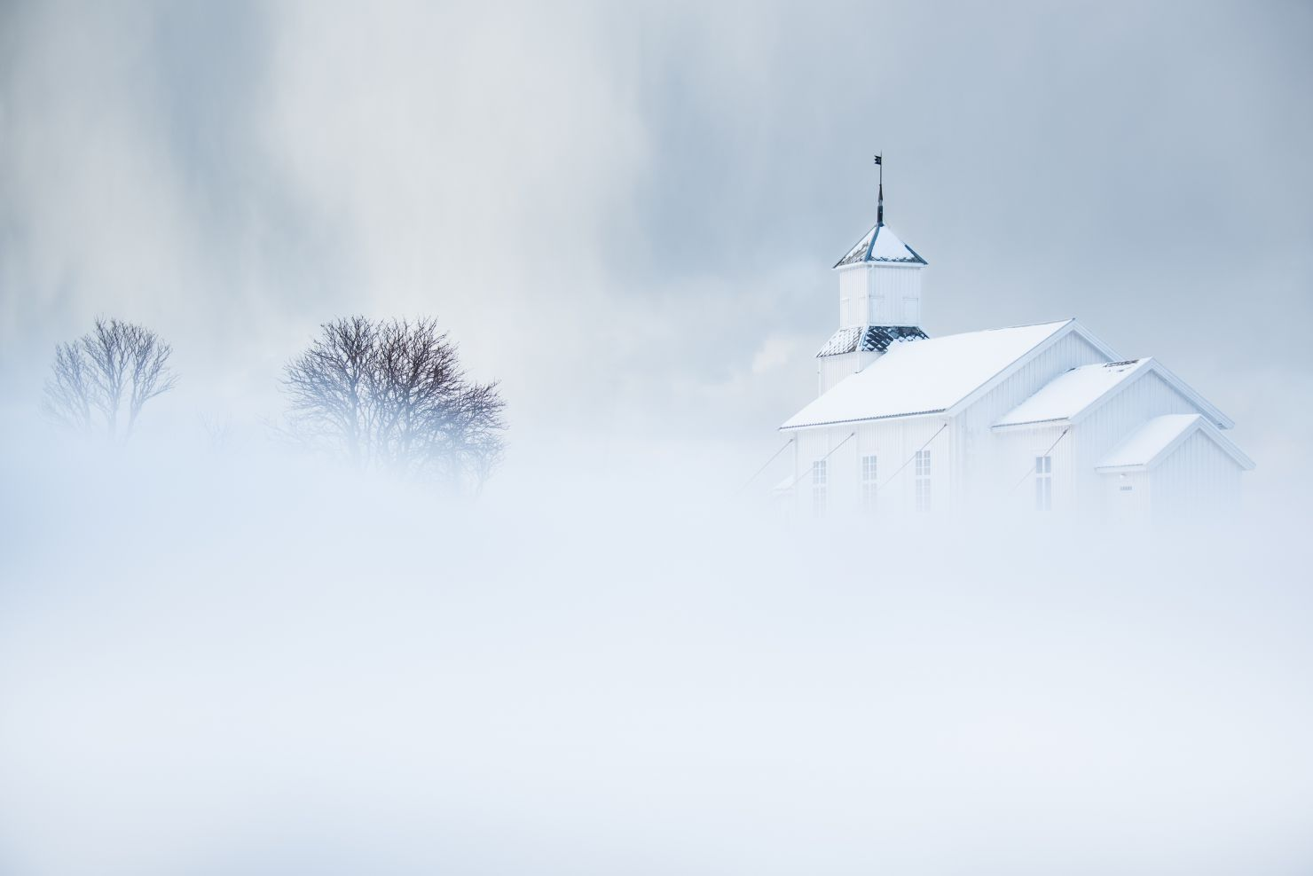 Curch with thunderclouds and snow